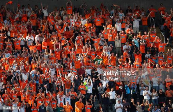 Blackpool fans celebrate victory during the Barclays Premier League match between Newcastle United and Blackpool at St James' Park on September 11...
