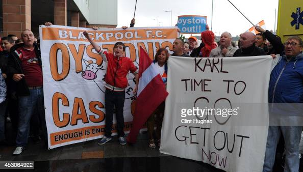 Blackpool fans hold a protest outside the ground against club chairman Karl Oyston during the Pre Season Friendly match between Blackpool and Burnley...