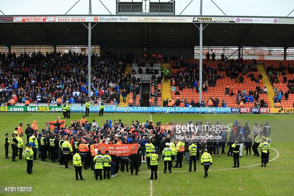 Blackpool fans invade the pitch and take part in a protest during the Sky Bet Championship match between Blackpool and Huddersfield Town at...