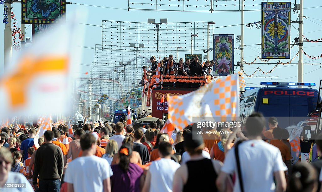 Blackpool football club players and family parade along Blackpool Promenade in Blackpool, north west England, on May 24, 2010, on a open top bus after winning promotion to the Premier League.
