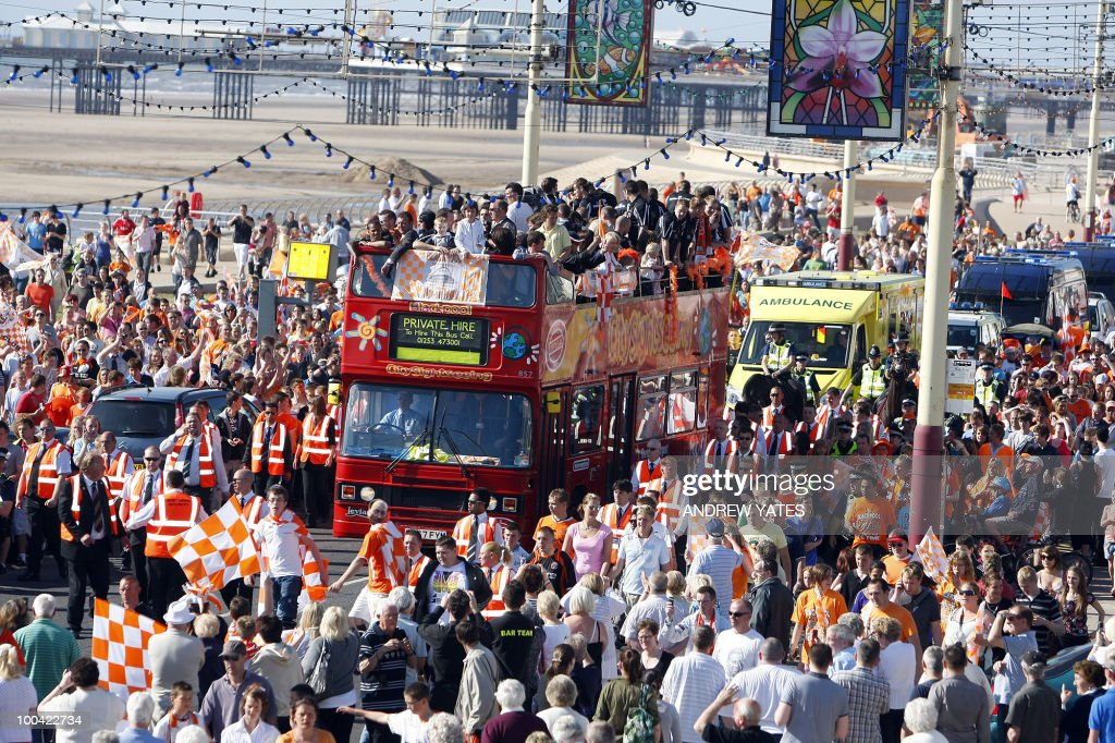 Blackpool football club players and family parade along Blackpool Promanade in Blackpool, north west England, on May 24, 2010, on a open top bus after winning promotion to the Premier League.