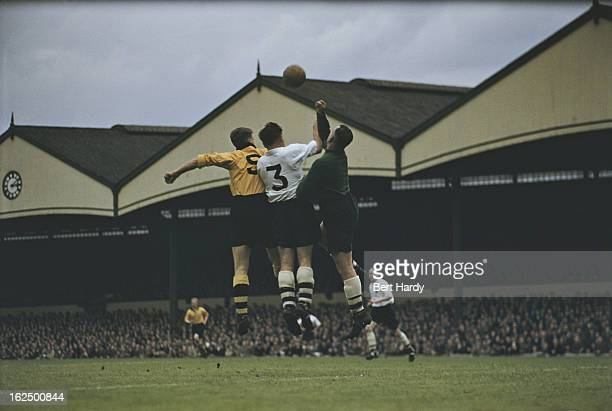 Blackpool goalkeeper George Farm right attempts to punch the ball clear during a match against Wolverhampton Wanderers at Molineux Stadium...