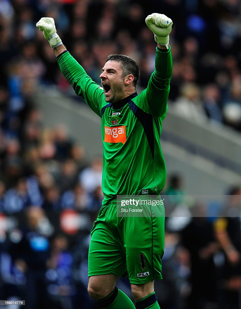 Blackpool keeper Matt Gilks celebrates the first Blackpool goal during the npower Championship match between Bolton Wanderers and Blackpool at Reebok Stadium on May 4, 2013 in Bolton, England.