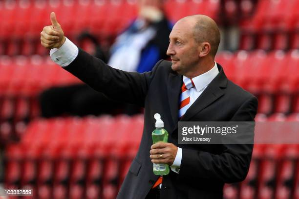 Blackpool Manager Ian Holloway gives a thumbs up during the Barclays Premier League match between Wigan Athletic and Blackpool at the DW Stadium on...