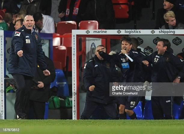 Blackpool manager Michael Appleton celebrates after his side score a late equaliser during the npower Championship match between Crystal Palace and...