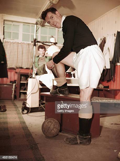 Blackpool player Allan Brown pictured in the changing room putting on his shin pad circa 1953 Brown played over 500 league games in England and...