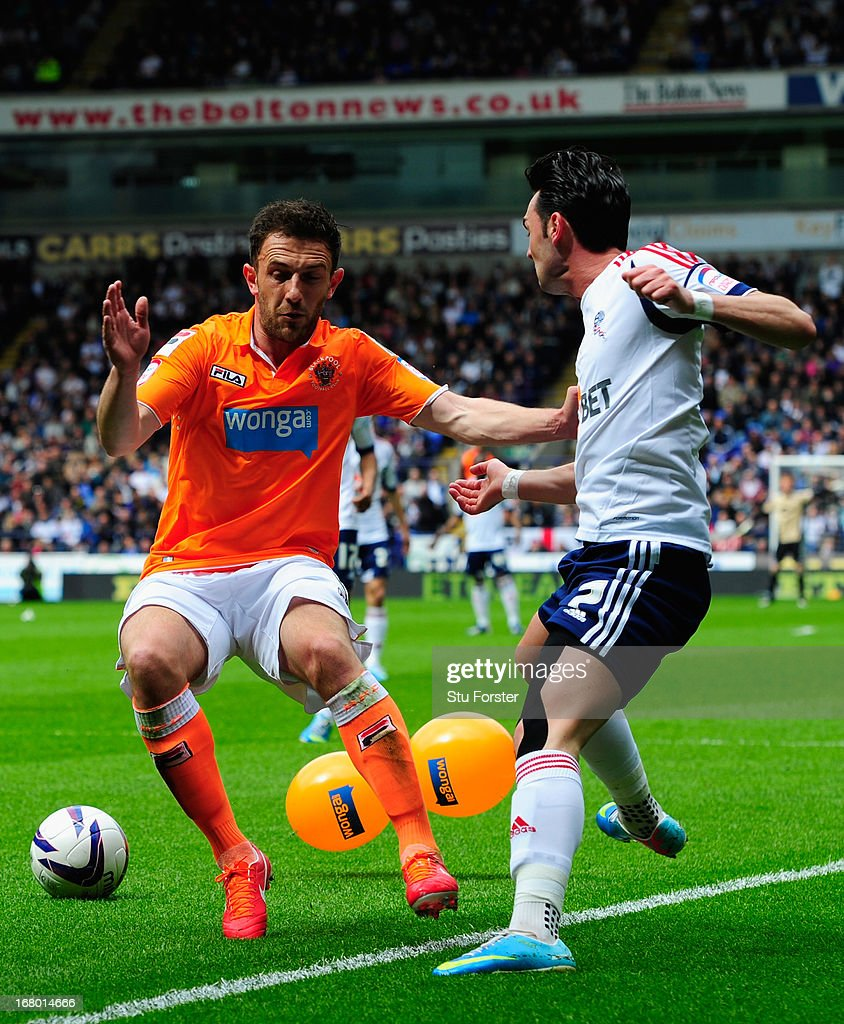 Blackpool player Neal Eardley (l) challenges Bolton player Chris Eagles and two balloons during the npower Championship match between Bolton Wanderers and Blackpool at Reebok Stadium on May 4, 2013 in Bolton, England.