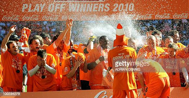 Blackpool players celebrate after beating Cardiff City during the 2010 Championship playoff final football match at Wembley Stadium in London on May...
