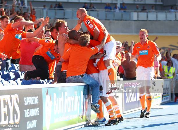 Blackpool players celebrate with their supporters after scoring the equalising goal against Brighton Hove Albion during the npower Championship match...