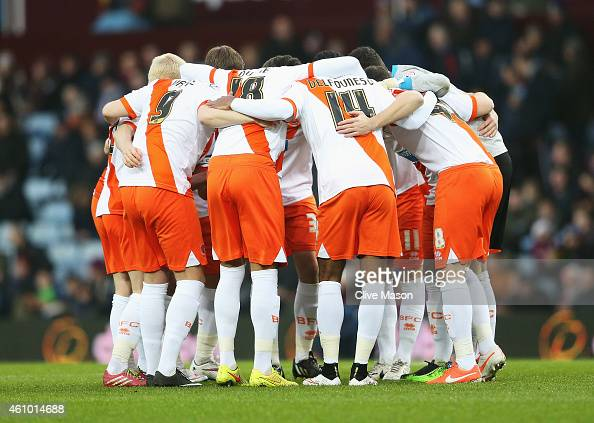 Blackpool players huddle during the FA Cup Third Round match between Aston Villa and Blackpool at Villa Park on January 4 2015 in Birmingham England