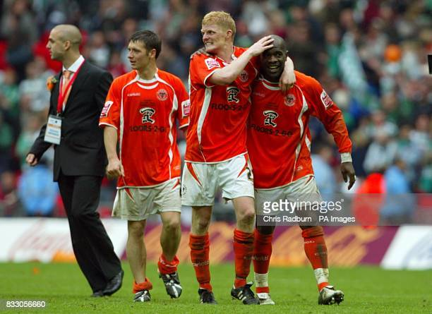 Blackpool's Adrian Forbes Keigan Parker and Claus Bech Jorgensen celebrate victory after the final whistle