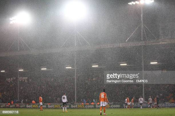 Blackpool's and Derby County's players during a hail storm at Bloomfield Road