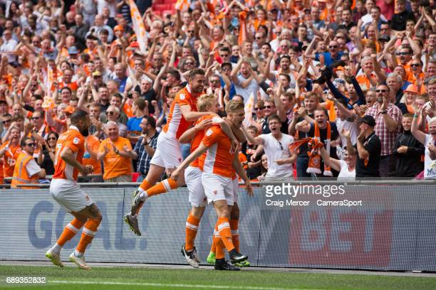 Blackpool's Brad Potts celebrates with team mates after scoring the opening goal during the EFL Sky Bet League Two PlayOff Final match between...