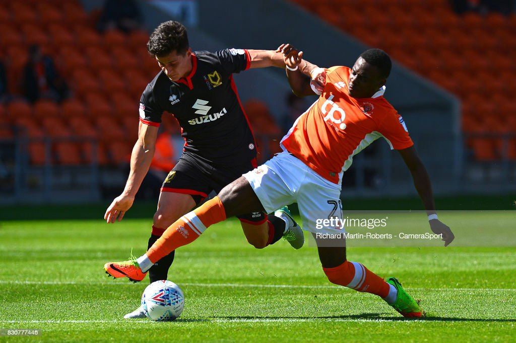 Blackpool's Bright Osayi-Samuel battles with Milton Keynes Dons' George Williams during the Sky Bet League One match between Blackpool and Milton Keynes Dons at Bloomfield Road on August 12, 2017 in Blackpool, England.