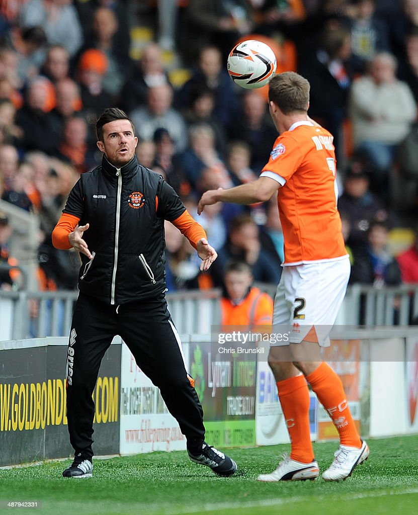 Blackpool's caretaker manager Barry Ferguson throws the ball back to Tony McMahon during the Sky Bet Championship match between Blackpool and...