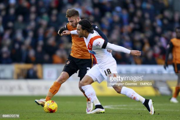 Blackpool's Charles Dunne and Wolverhampton Wanderers' James Henry in action