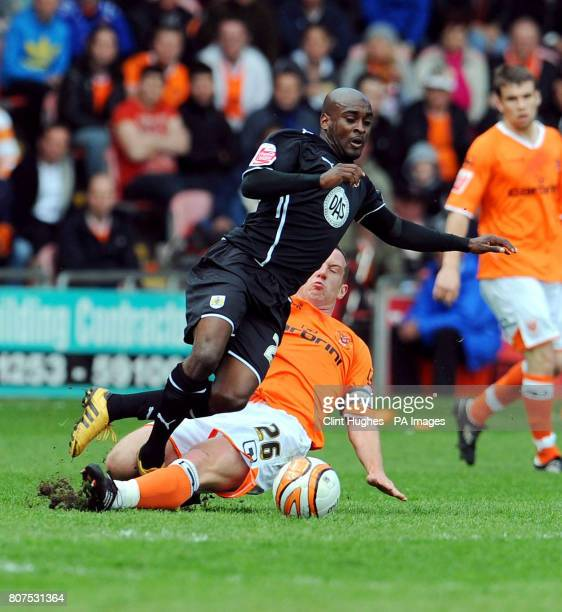 Blackpool's Charlie Adam challenges Bristol City's Jamal CampbellRyce during the CocaCola Championship Match at Bloomfield Road Blackpool