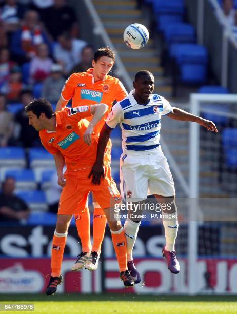 Blackpool's Craig Cathcart wins a header above Reading's Benik Afobe during the npower Championship match at the Madejski Stadium Reading