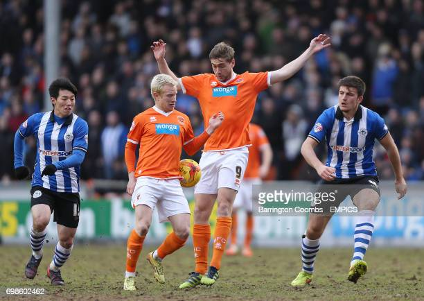 Blackpool's David Perkins and Steven Davies battle with Wigan Athletic's Kim Bo Kyung and Harry Maguire