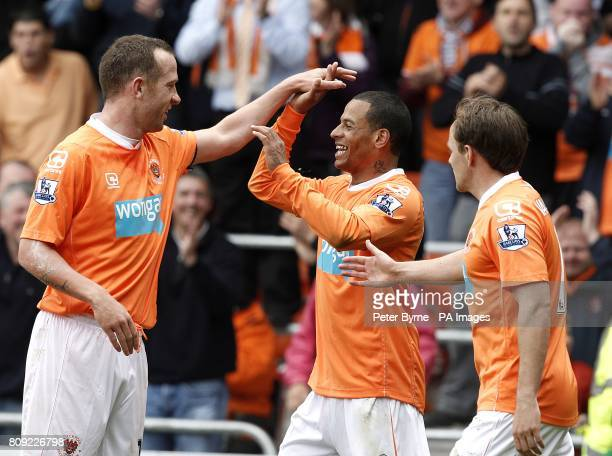 Blackpool's Dudley Campbell celebrates with teammate Charlie Adam after scoring his team's third goal