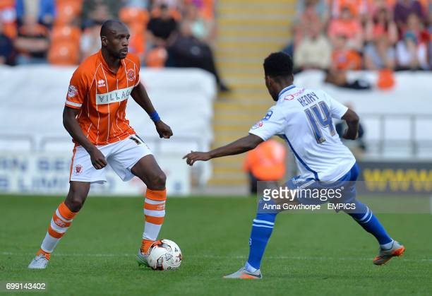 Blackpool's Emmerson Boyce and Walsall's Rico Henry in action