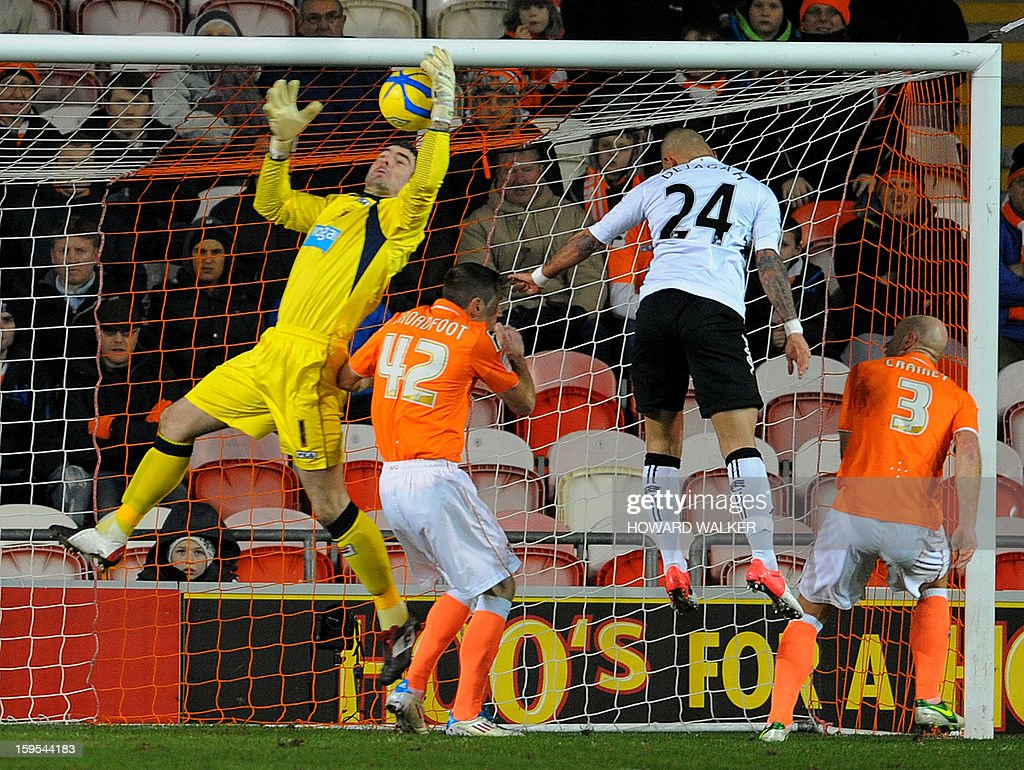 """Blackpool's English goalkeeper Matthew Gilks (L) intercepts a cross in front of the waiting Fulham's Iranian midfielder Ashkan Dejagah (2R) during the English FA Cup third round replay football match between Blackpool and Fulham at Bloomfield Road in Blackpool, northwest England, on January 15, 2013. USE. No use with unauthorized audio, video, data, fixture lists, club/league logos or """"live"""" services. Online in-match use limited to 45 images, no video emulation. No use in betting, games or single club/league/player publications."""
