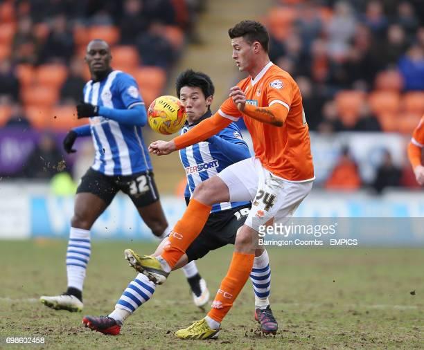 Blackpool's Gary Madine and Wigan Athletic's Kim Bo Kyung