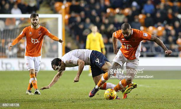 Blackpool's Kyle Vassell gets away from Luton Town's Danny Hylton during the Sky Bet League Two match between Blackpool and Luton Town at Bloomfield...