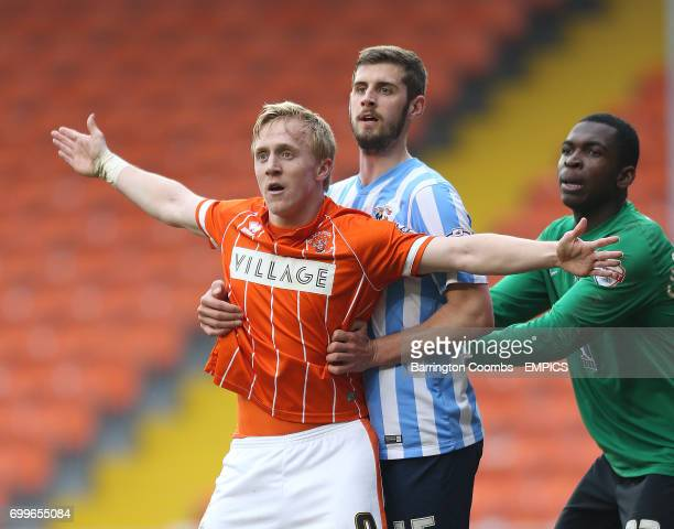 Blackpool's Mark Cullen and Coventry City's Jack Stephens and Coventry goalkeeper Reice CharlesCook tussle for position in the box