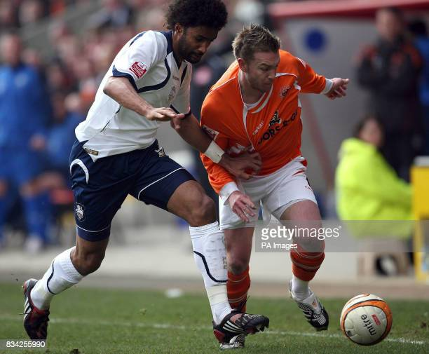 Blackpool's Stephen McPhee and Preston's Youl Mawene battle for the ball during the CocaCola Championship match at Bloomfield Road Blackpool