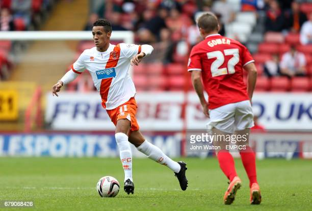 Blackpool's Thomas Ince runs at Charlton Athletic's Mark Gower
