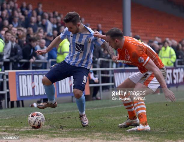 Blackpool's Tom Aldred and Coventry City's Adam Armstrong battle for the ball