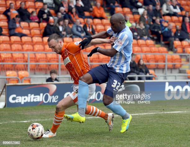 Blackpool's Tom Aldred and Coventry City's Marc AntoineFortune battle for the ball