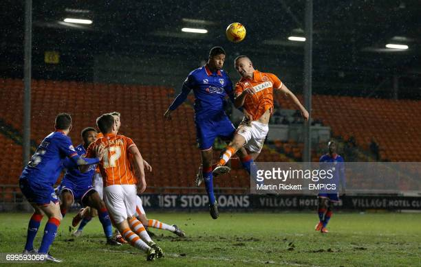 Blackpool's Tom Aldred battles for the ball with Oldham Athletics Timothee Dieng