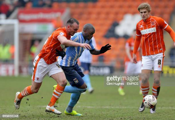 Blackpool's Tom Aldred battles with Coventry City's MarcAntoine Fortune