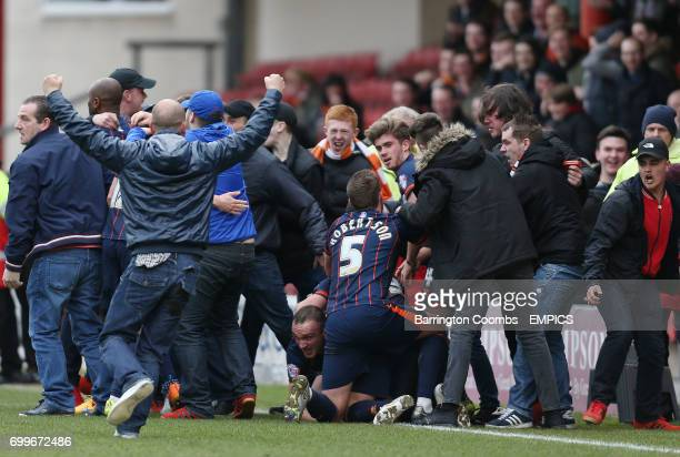 Blackpool's Tom Aldred celebrates scoring the 2nd goal against Crewe with his team mates and fans