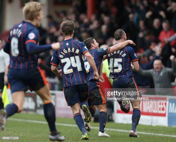 Blackpool's Tom Aldred celebrates scoring the second goal against Crewe with his team mates
