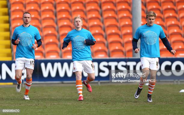 Blackpool's Tom Aldred Mark Cullen and Brad Potts warm up before the game