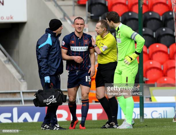 Blackpool's Tom Aldred receives attention