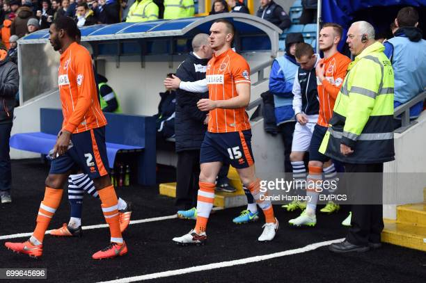 Blackpool's Tom Aldred walks out with his teammates