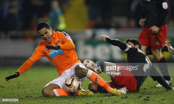 Blackpool's Tom Ince and Cardiff City's Peter Whittingham during the npower Championship match at Bloomfield Road Blackpool