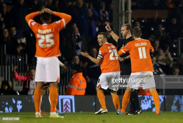 Blackpool's Tony McMahon is sent off by referee Robert Madley