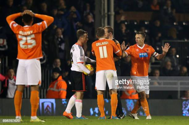 Blackpool's Tony McMahon protests his innocence after being sent off by referee Robert Madley