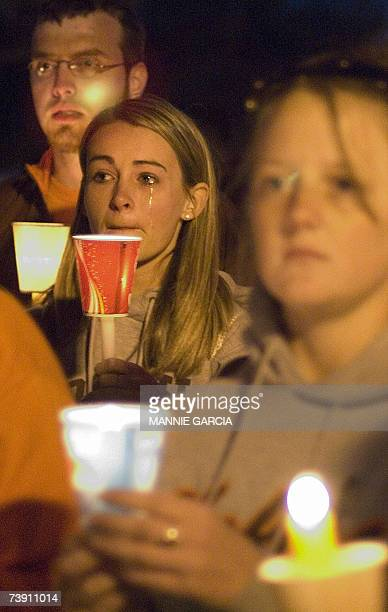 Students participate in a candle light vigil on Drill Field at Virginia Tech 17 April 2007 in Blacksburg Virginia one day after the university was...