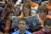Virginia Tech students read their school newspaper prior to the start of a convocation in Cassell Coliseum at Virginia Tech in Blacksburg Virginia 17...