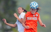 Blacksburg's Kim Shaver left gives way to Briar Woods' Carly Melkus right on a header as Briar Woods defeats Blacksburg 1 0 in the girls Virginia AA...