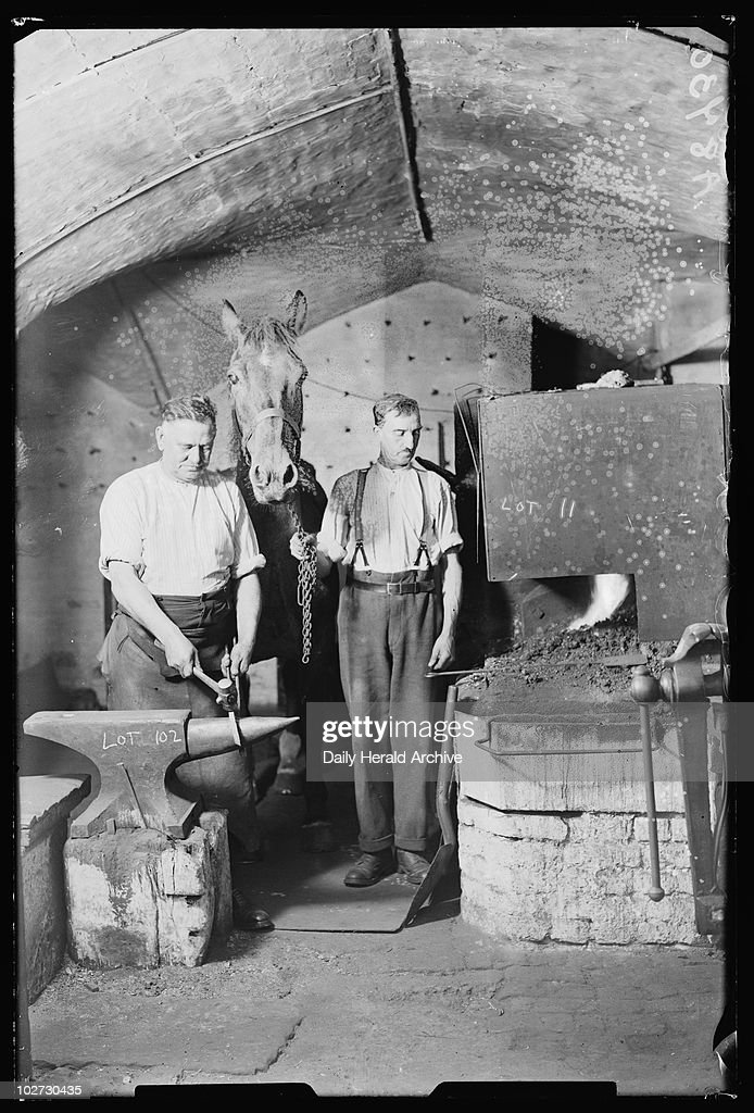 Blacksmith at work, 1932. A photograph of blacksmith Sam King at work on his anvil in Tweezers Alley, taken by James Jarche for the Daily Herald newspaper on 5 September, 1932. The Daily Herald notes that the horse's name was Jock. This photograph has been selected from the Daily Herald Archive, a collection of over three million photographs. The archive holds work of international, national and local importance by both staff and agency photographers.