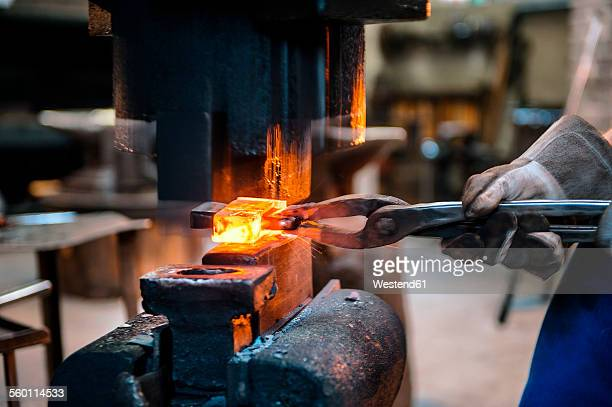 Blacksmith forging hatchet
