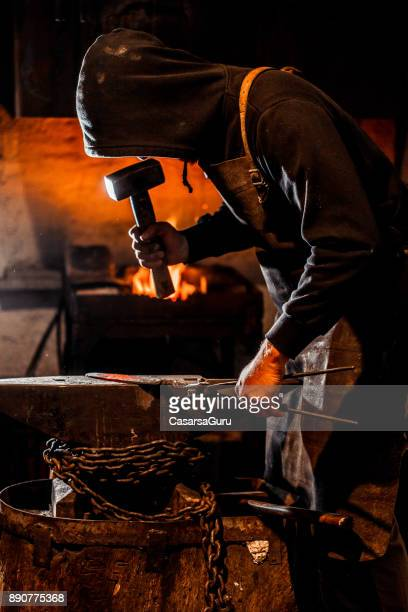 Blacksmith Forging Knife Blade on Anvil with a Hammer