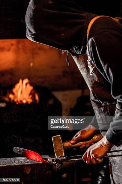 Blacksmith Forging Knife Blade with a Hammer